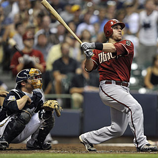 Miguel Montero takes a look at his solo shot, the second of the four home runs in the fourth inning. (AP)