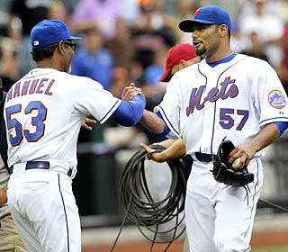 Johan Santana makes manager Jerry Manuel proud in the absence of suspended closer Francisco Rodriguez. (AP)