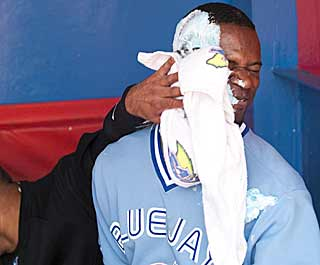 It's a pie in the face for Fred Lewis after his sac fly in the ninth caps a four-run rally for the Jays. (AP)