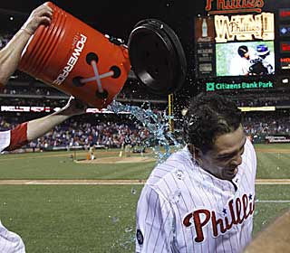 Carlos Ruiz catches a bath after smacking a double off the wall off to seal a crazy win for Philly. (AP)