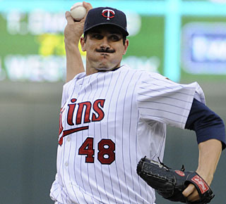 Carl Pavano allows two runs, working into the seventh inning to earn the victory. (AP)
