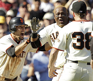 Juan Uribe collects two hits on Saturday -- the second of which caps the Giants' comeback.  (AP)