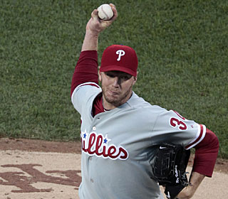 Roy Halladay has a good game overall as he collects his 15th win, has a hit and also scores a run. (AP)