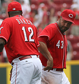 Reds manager Dusty Baker (12) congratulates Miguel Cairo after Sunday's 2-0 win over Florida.  (AP)