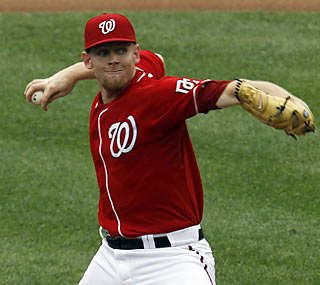 Stephen Strasburg strikes out seven batters in five innings of work against the D-Backs.  (AP)