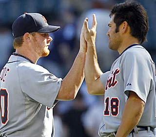 Phil Coke celebrates with Johnny Damon as Detroit wins to snap a string of 10 straight road series losses. (AP)