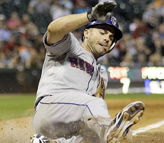 David Wright slides home with the game-winning run after a Matt Lindstrom wild pitch.  (AP)