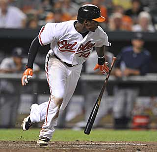 Adam Jones hustles down the line after dropping down a bunt in the bottom of the 11th. (AP)