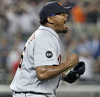 Jose Valverde celebrates after pitching his way out of a bases-loaded jam in the ninth. (AP)