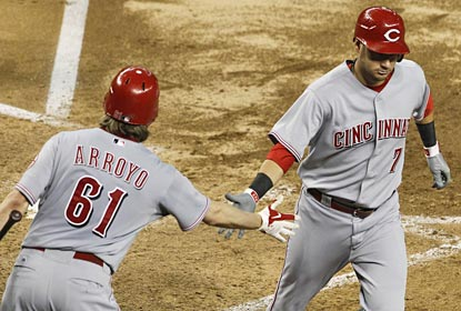 Paul Janish and Bronson Arroyo tag-team to move the Reds 17 games over .500 for the first time since 1999.  (AP)