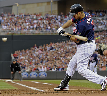 Twins catcher Joe Mauer racks up four hits, including his first home run at Target Field during the regular season.  (AP)