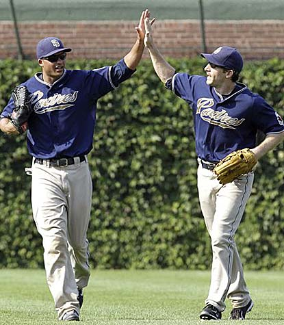 San Diego's Will Venable and Chris Denorfia celebrate the first four-game sweep of the Cubs in the history of the franchise.  (AP)