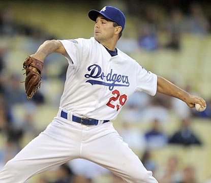 Ted Lilly faces only 30 batters -- and retires 19 of them in succession -- in his first complete game in six years.  (AP)