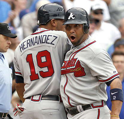 Alex Gonzalez celebrates after scoring on Rick Ankiel's bases-clearing triple in the ninth.  (AP)