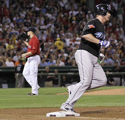 Lyle Overbay, who goes 4 for 5, rounds the bases during one of his two three-run homers as Jon Lester searches for answers.  (AP)