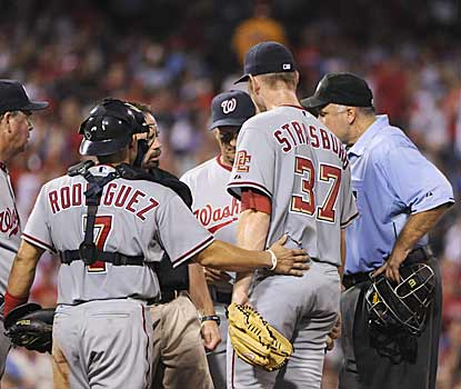 Stephen Strasburg draws a lot of attention after giving an indication that he was feeling pain in his arm. (AP)
