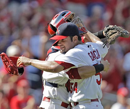 Jaime Garcia is congratulated by Yadier Molina after the rookie hurler completes his first career shutout.  (AP)