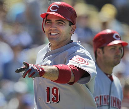 Joey Votto continues his push toward the Triple Crown with a home run and three more RBI.  (AP)