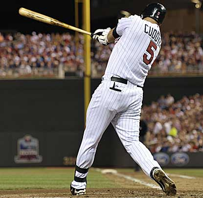 Michael Cuddyer rips a double that drives in three runs, which is more than enough for Scott Baker and the Twins. (AP)