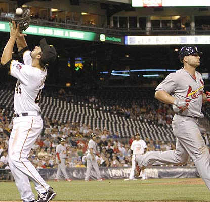 Matt Holliday blows a bases-loaded opportunity in the ninth when he hits a harmless pop fly. (AP)