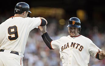 Pat Burrell, added in June, and Cody Ross, added Monday, won't mind getting fewer at-bats if the Giants keep hitting like this. (AP)