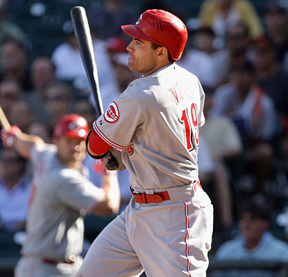 Joey Votto completes this game with his fourth hit, a two-out single that drives in the go-ahead run in the 12th inning. (Getty Images)