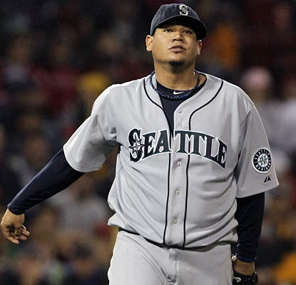 Mariners ace Felix Hernandez strikes out nine, in the process reaching the 1,000-strikeout milestone at the age of 24.  (AP)