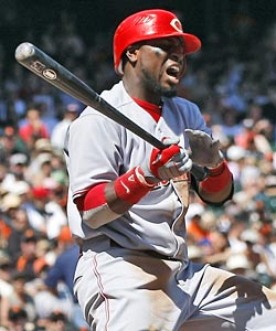 Brandon Phillips suffers an injury in the gutty win, a cause for concern. (AP)