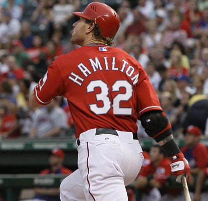 Josh Hamilton follows through after belting his 30th home run of the season, a two-run shot in the first inning.  (AP)