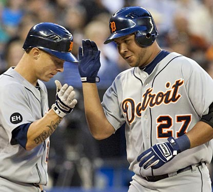 Jhonny Peralta gets a high-five after he hits a big three-run home run to back Max Scherzer's effort.  (AP)