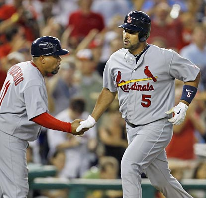 Albert Pujols reaches the 400-homer mark faster than anybody outside of Alex Rodriguez and Ken Griffey Jr.  (AP)