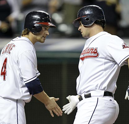 Trevor Crowe greets Matt LaPorta after LaPorta clubs a go-ahead two-run homer.  (AP)