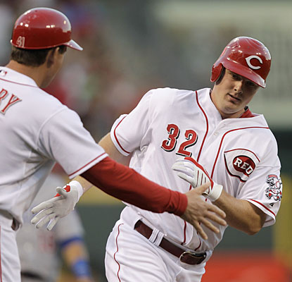 Jay Bruce rounds the bases during one of his three homers, matching a career high with five RBI.  (AP)