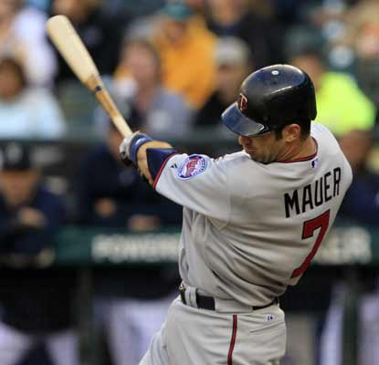 Joe Mauer snags three hits and two RBI in a stellar outing against the Mariners. (AP)