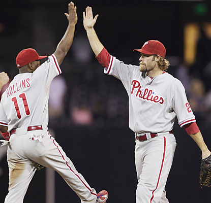 Jimmy Rollins and Jayson Werth celebrate after the Phillies have to work extras to put away the NL West-leading Padres.  (AP)
