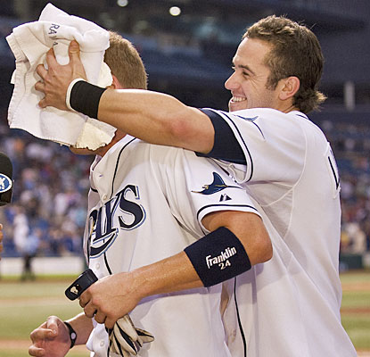 Evan Longoria gives Dan Johnson the ceremonial pie in the face after Johnson's walk-off blast.  (AP)