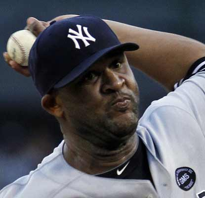 CC Sabathia hurls 7 strong innings against the ChiSox to become the season's first 18-game winner.  (AP)