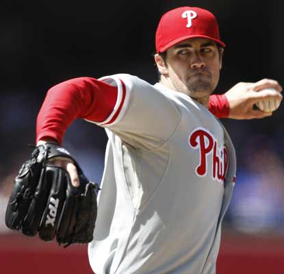 Cole Hamels retires his final 16 batters to lead the Phils past the stumbling, NL West-leading Padres. (AP)