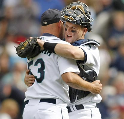 Adam Moore, who drives in the winning run, congratulates David Aardsma after he picks up the save.  (AP)