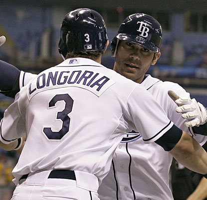 Evan Longoria greets Carlos Pena after Pena's three-run shot in the third inning.  (AP)