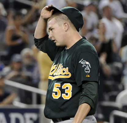 Trevor Cahill looks dejected after allowing back-to-back home runs in the third to Mark Teixeira and Robinson Cano. (AP)