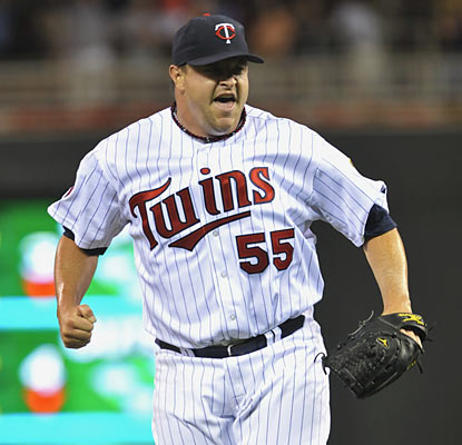 Matt Capps celebrates his 33rd save of the season and seventh since joining Minnesota.  (AP)