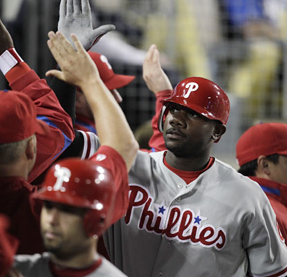 Slugger Ryan Howard provides one of two three-run home runs for the Phillies, who keep pace behind Atlanta in the NL East. (AP)