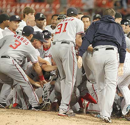 A baseball game turns into a royal rumble after Chris Volstad throws behind Nyjer Morgan in the sixth inning.  (AP)