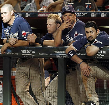 The Padres look on as their losing streak reaches seven and their division lead continues to dwindle.  (AP)