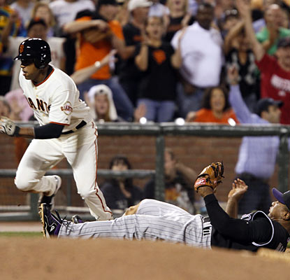 Called up on Wednesday, Darren Ford races home for the go-ahead run with Melvin Mora powerless to stop him.  (AP)