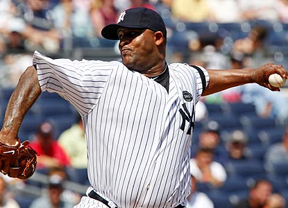 CC Sabathia pitches eight innings of 1-hit ball and picks up his major league-leading 19th victory. (AP)