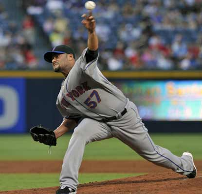 Johan Santana pitches five innings -- his shortest outing in 23 starts -- to help the Mets down the Braves. (AP)