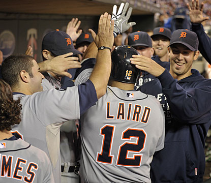 Gerald Laird is mobbed by his Tigers teammates in the dugout after his timely home run. (AP)