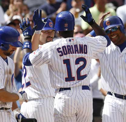 Alfonso Soriano is congratulated by Xavier Nady and Marlon Byrd after hitting a three-run HR against the Mets. (AP)